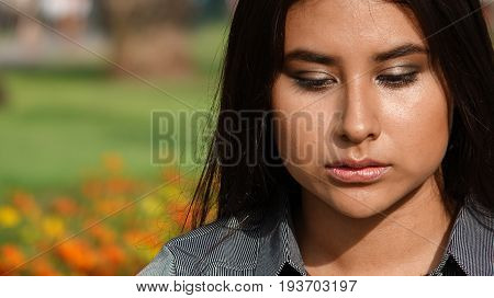 Female Teen And Confusion with Flowers in Background