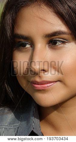 A Headshot Portrait of a Smirking Person