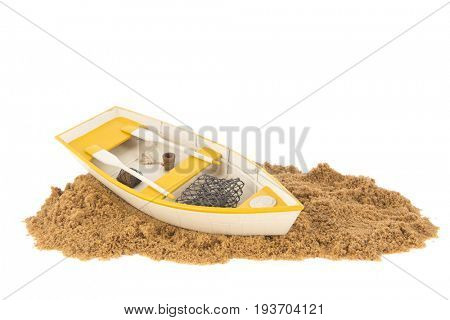 Wooden yellow row boat at the beach isolated over white background