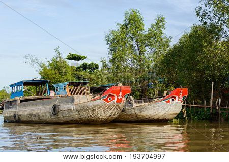 Wooden cargo boat on the Mekong River Delta Vietnam