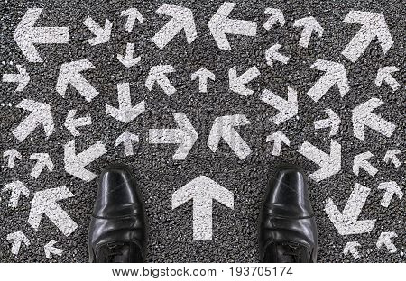 a salaman shoes standing on concrete road who confusing to choose the next way or next step for his life concept.