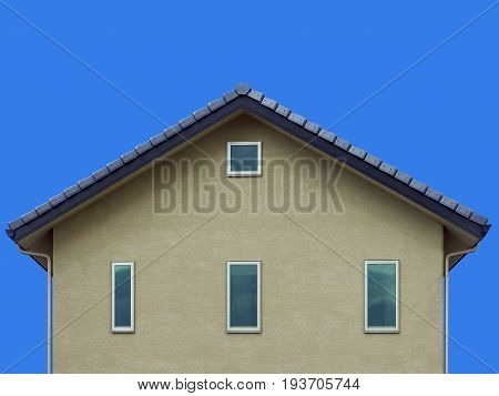 gray house wall gable asian style roof and clear blue sky