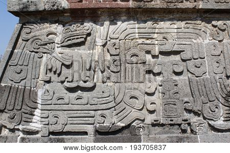 Bas-relief carving with of a Quetzalcoatl, pre-Columbian Maya civilization, Temple of the Feathered Serpent in Xochicalco, Mexico. UNESCO world heritage site