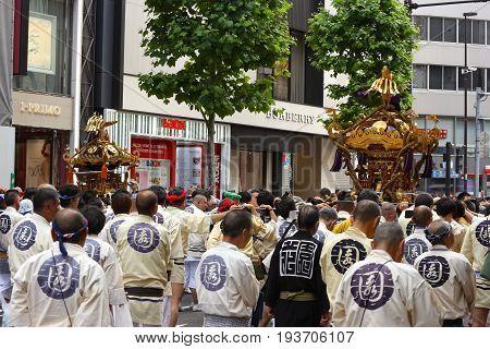 2017 05 28. SHINJUKU TOKYO JAPAN. People are carrying a portable shrine on their shoulders and walking around shinjuku city. known as OMIKOSHI MASTURI FESTIVAL at HANAZONO JINJA, SHINJUKU TOKYO JAPAN