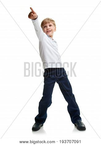 Full portrait of little boy in formalwear pointing on white background