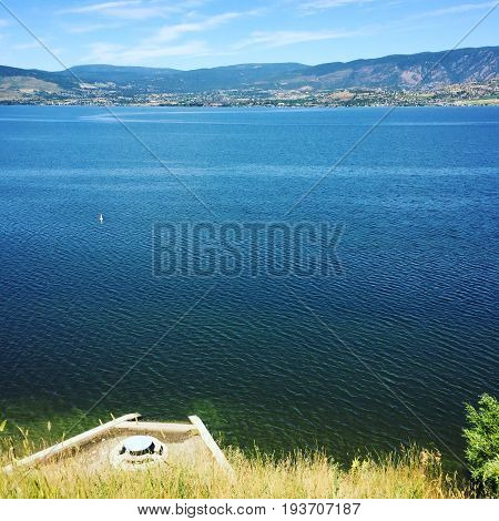 Hilltop View Of Lake And Mountains