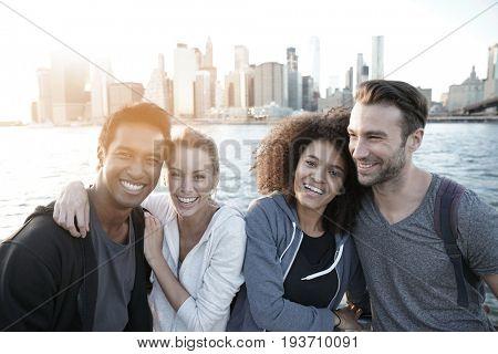 Group of friends enjoying sunset on Brooklyn heights promenade, NYC