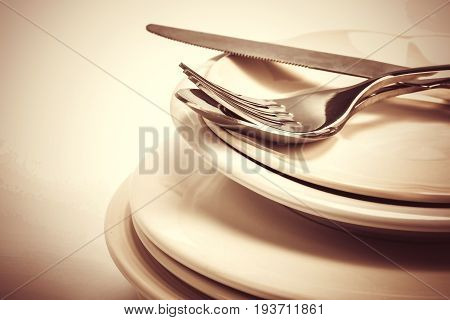 close up dinning the silverware fork spoon and knife with dish on white background and text space