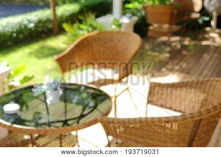 Blur Image Interior Decoretion, Glass Table And Seat Chair Outside The Garden