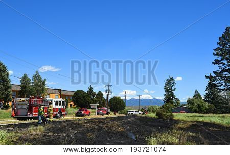 KALISPELL, MONTANA, USA - June 21, 2017: Fire and police crews on scene at a grass fire