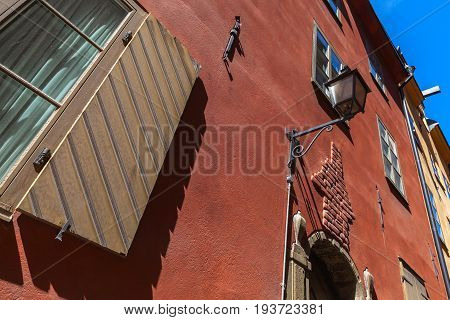 Old Living House Facade With Street Lamp
