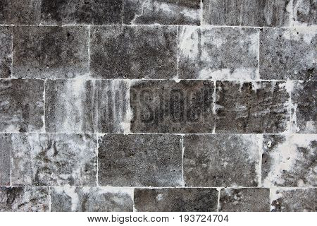 Old wall made of light stones, the masonry background