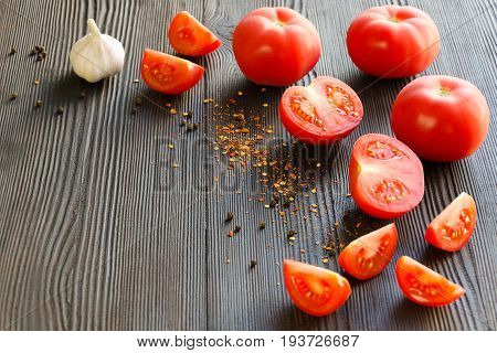 Juicy ripe tomatoes. Ingredients for tomato sauce. Selective focus. Copy-space composition