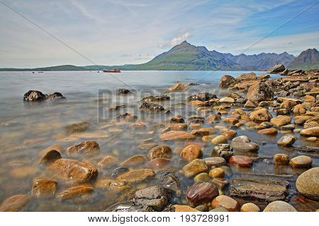 View of the Black Cuillin mountain range from the beach of Elgol across Loch Scacaig, Isle of Skye, Highlands, Scotland, UK