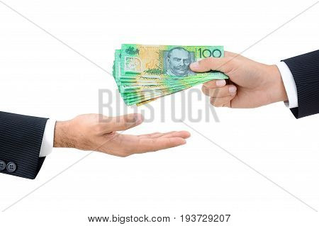 Businessman hands passing money Australian dollar (AUD) banknotes isolated on white background