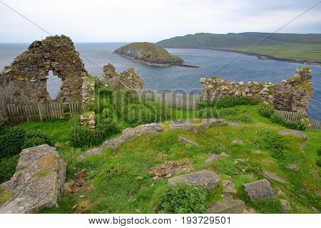 The ruins of Duntulm Castle with Tulm Island in the background in the northern part of the Trotternish peninsula, Isle of Skye, Highlands, Scotland, UK