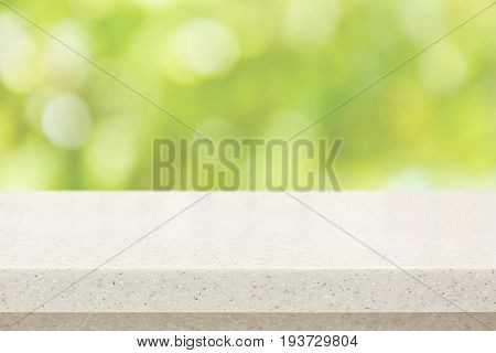White quartz stone countertop on bokeh green background - can be used for display or montage your products