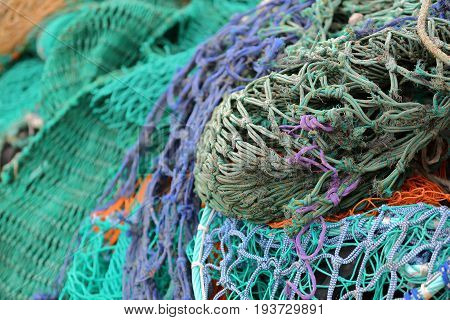Close-up on colorful fishing nets in the Portree fishing harbor, Isle of Skye, Highlands, Scotland, UK