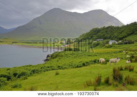View from the An Aird peninsula towards the mountain Beinn na Caillich, Isle of Skye, Highlands, Scotland, UK