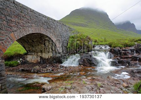 An old bridge and the river Russel on the road leading to the Bealach na Ba pass near Applecross in the western part of the Northern Highlands, Scotland, UK