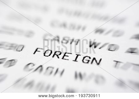 Text on bank statement paper focused on the word FOREIGN