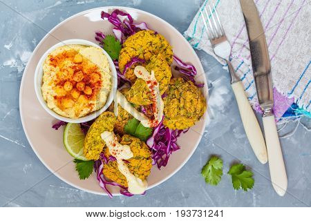Baked falafel with hummus and vegetables. Love for a healthy vegan food concept.