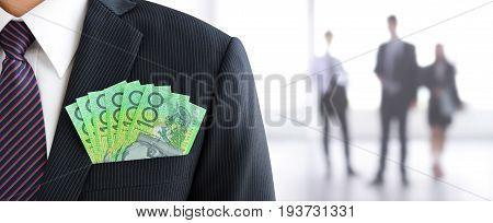 Money Australian dollar (AUD) banknotes in businessman suit pocket - business and financial panoramic header background