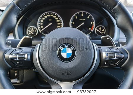 Sankt-Petersburg Russia March 05 2017: BMW X5M 2017 close up of steering wheel dashboard modern car interior details on the test-drive in Sankt-Petersburg at March 05 2017
