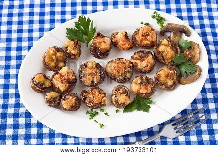Stuffed mushrooms with breadcrumbs, cheese and chopped mushroom stems
