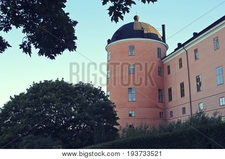 Beautiful summer season specific photograph. An old castle in Uppsala, Sweden. Great colors and beautiful blue sky.