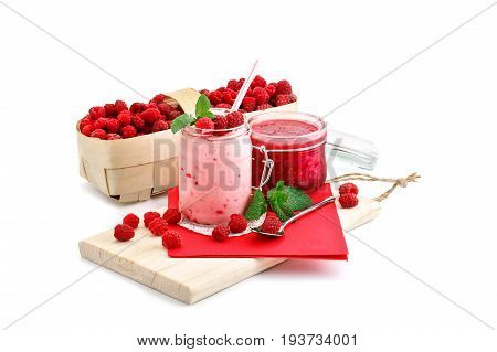 Raspberry smoothies, raspberry jam and a basket with ripe raspberries on a white background. An isolated object.