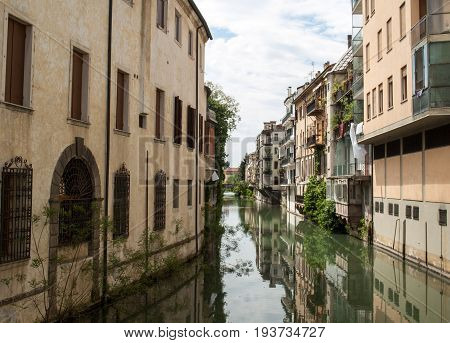 The city canal San Massimo runs among residential houses in the centre of the old city Padua Veneto Italy