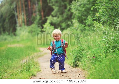 cute little girl go to daycare in nature