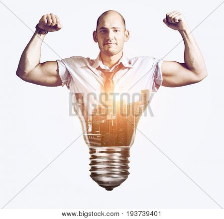Strong business idea. Businessman showing muscular hands, double exposure mixed with sunset city skyline and bulb