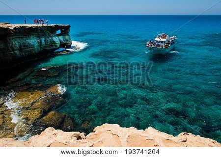 Tourists Visiting The Sea Caves Of Ayia Napa, Cyprus