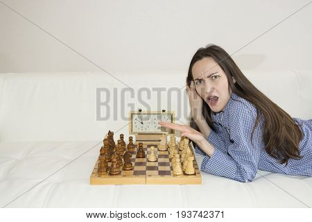 The Indignant Woman Is Playing Chess, Where The Partner.