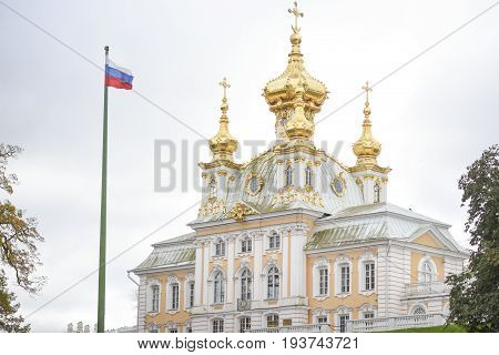 Peterhof Russia October 5 2016: Building in Peterhof Palace in Russia with russian flag.