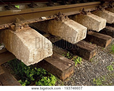 Concrete And Wooden Sleepers Extracted  With Rail Rods In Railway Station Stock Waiting For Transpor
