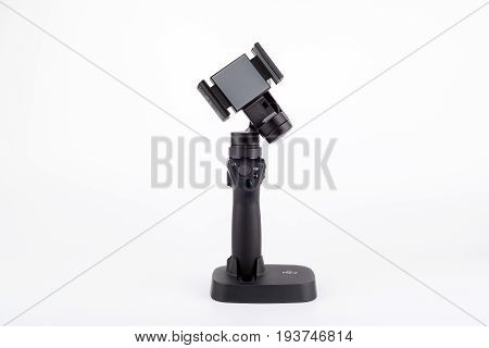 Riga, Latvia - July 3, 2017: New DJI Osmo Mobile gimbal stand for smartphone. The DJI Osmo hardware and mobile app allows smooth video shooting. 4k, Ultra HD