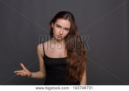 Tough girl. Angry woman raise hand about to slap. Upset girl ready to fight and quarrel, looking at camera
