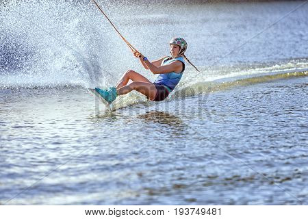 Woman surfs on the water a summer kind of extreme sports.