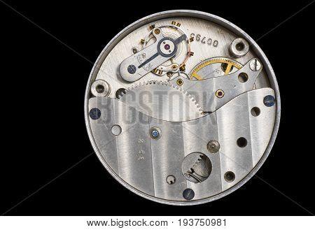 An old clockwork on a black background