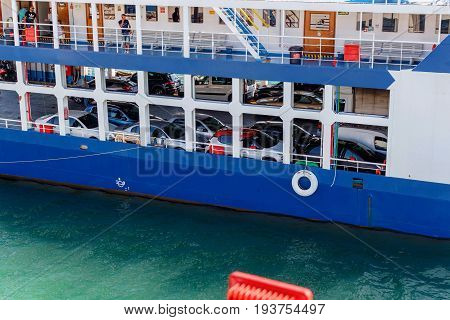 CORFU ISLAND, GREECE - JUNE 26, 2017: Car ferry and people departing from Corfu island, Greece