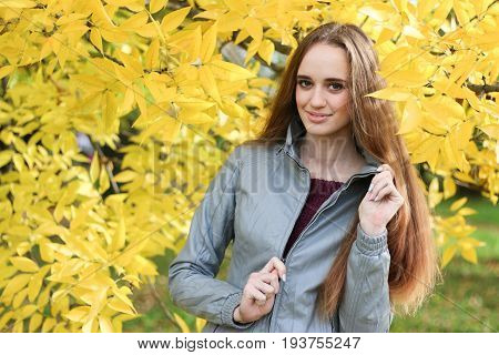 young female unbuttoned jacket in autumn outdoor.