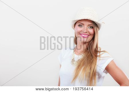 Woman Wearing White Top And Light Sun Hat