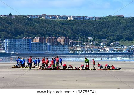 westward ho! Devon England - 2 July 2017 Teams of young people on the beach at Westward Ho!. being trained in how to surf safely.