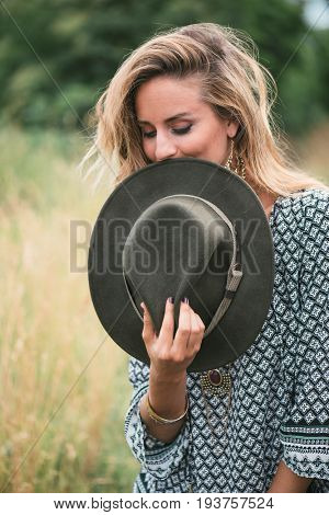 Beautiful traveler woman with hat outdoors
