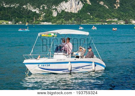 ANNECY FRANCE - JUNE 17 2017: Senior men's enjoy activities on motor boat at Annecy lake