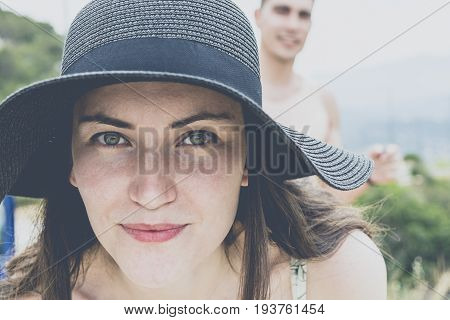 Portrait Of Young Couple Smiling In The Journey Around The Island On A Sunny Day. Girl Close-up The