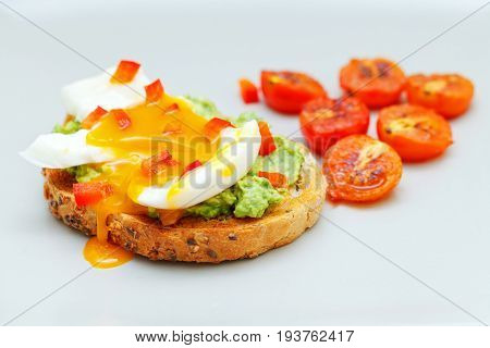 Picture of guacamole toast with boiled egg and cherry tomato on isolated background